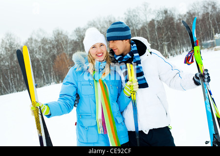 happy young couple going skiing on a warm winter day - Stock Photo