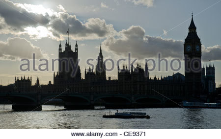 Palace of Westminster on the River Thames in London in silhouette, in Westminster, City of Westminster, London, - Stock Photo
