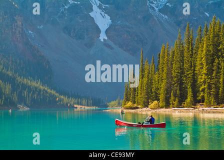 One man in a hire canoe on Moraine Lake Banff national Park Alberta Canada North America - Stock Photo