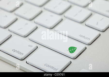 Computer keyboard with leaf icon on key - Stock Photo