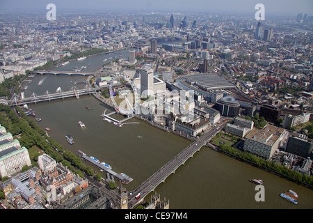 aerial view looking across Westminster Bridge and the River Thames towards the London Eye on the south bank in Lambeth, - Stock Photo