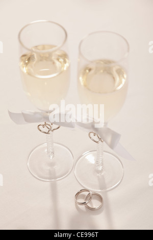 Wedding rings and champagne flutes