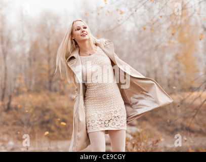 beautiful young blond woman spending time in the autumn park - Stock Photo