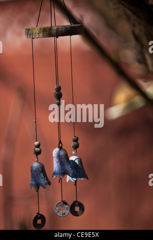A wind chime with little prayer bells - Stock Photo