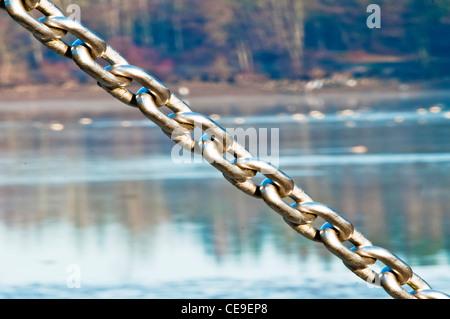 anchor chain at a lake - Stock Photo