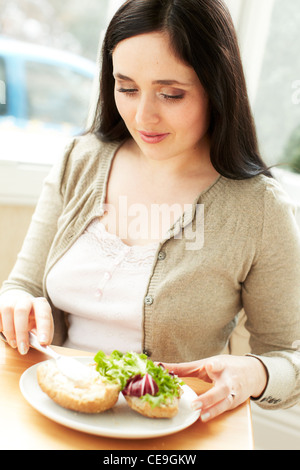 Woman eating healthy sandwich - Stock Photo