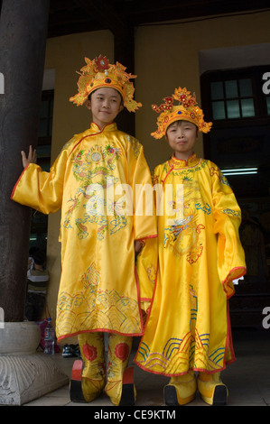 Children dressed in traditional royal court costumes in order to have their photographs taken at the Citadel in - Stock Photo