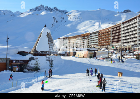 Flats, shops, apartments; hotels, cafe, club, Skiers,Walkers, Tignes, Vanoise Nature Park, Alps, France, Europe - Stock Photo