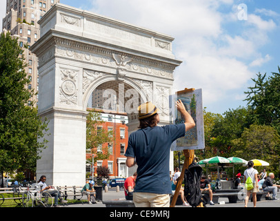 An artist works on his painting in Washington Square Park in Manhattan, New York City. - Stock Photo