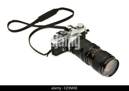 Vintage 35mm Olympus OM-2 SLR film camera with Vivitar zoom lens - Stock Photo