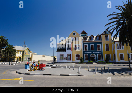 Mother, children, red shopping cart in front of Antonius Gebaude ( Residence) a former Franciscan hospital, Swakopmund, - Stock Photo
