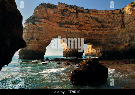 Portugal, Algarve: Rock arcades at the beach Praia da Marinha - Stock Photo
