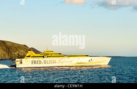 Fred Olsen line passenger car ferry Benchijigua Express leaving port of Los Cristianos, Tenerife for La Gomera, - Stock Photo