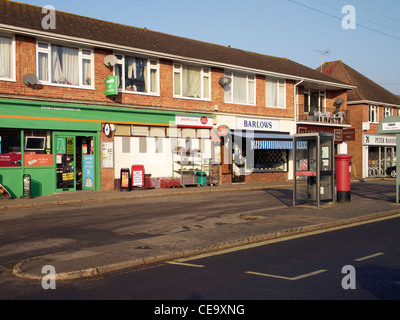 Parade of local shops with phone box, post box and bus shelter, in Olivers Battery a suburb of Winchester, Hampshire,. - Stock Photo