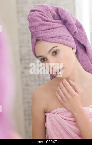 Woman applying ointment on lips - Stock Photo
