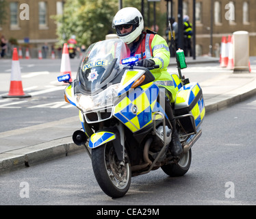 Policeman riding on a Police motorcycle - Stock Photo