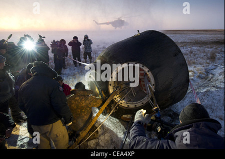 Expedition 29 Crew Lands Russian support personnel work to help get crew members out of the Soyuz TMA-02M spacecraft - Stock Photo