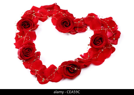 Heart of red rose petals isolated on white - Stock Photo