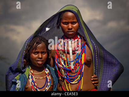 Young Erbore Girls With Beaded Necklaces Posing Under Large Canvas Ethiopia - Stock Photo