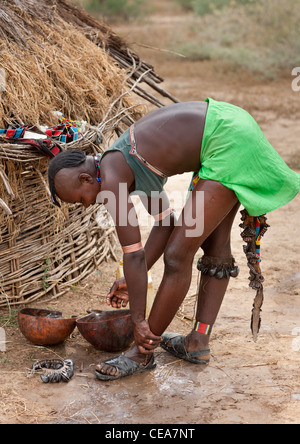Bana Woman With Original Hairstyle Washing Her Feet Ethiopia - Stock Photo