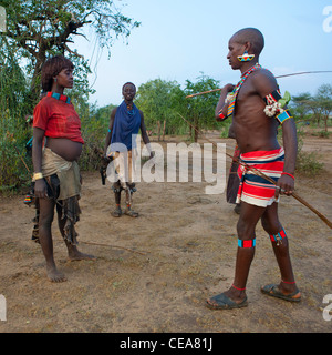 Bana Pregnant Woman Getting Flogged During Bull Jumping Ceremony Ethiopia - Stock Photo