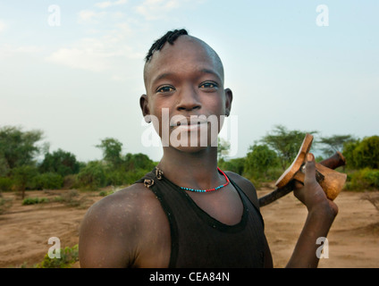 Bana Young Man Carrying Wooden Carved Headrest Omo Valley Ethiopia - Stock Photo