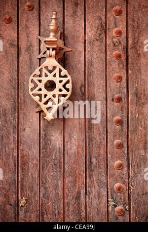 An ornate brass door knocker in Marrakech, Morocco - Stock Photo