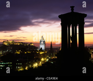The Dugald Stewart Monument on Calton Hill with view of City skyline at sunset, Edinburgh, Scotland, UK. - Stock Photo