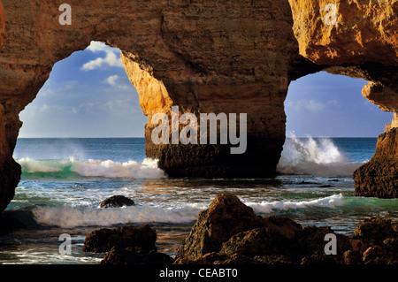 Portugal, Algarve: Rock arcades at beach Praia da Marinha near Carvoeiro - Stock Photo