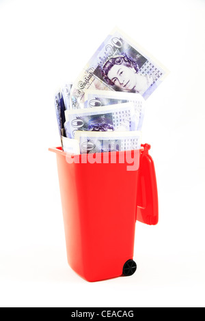 UK British English twenty pound notes note money currency sterling cash stg £s £20 cut out in a the rubbish wheelie - Stock Photo
