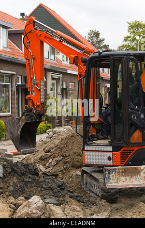 Breaking up the street to renew the sewerage - vertical image - Stock Photo