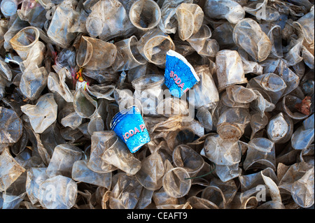 Discarded paper soda cups amongst plastic tea cups in the Indian countryside. Andhra Pradesh, India Stock Photo
