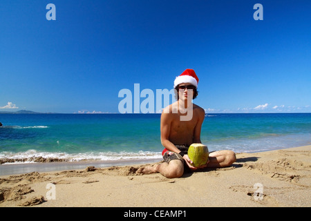 Happy Santa with coconut drink - Stock Photo