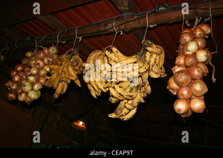 Onions And Bananas Hanging From The Rafters In a Traditional Costa Rica Restuarant - Stock Photo