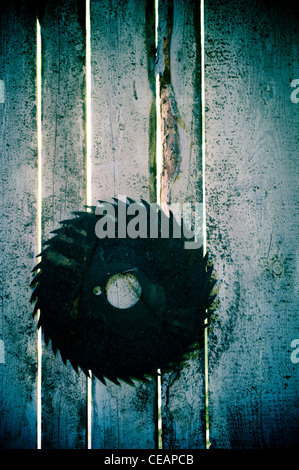 Rusty Rotary Blade hanging on wall - Stock Photo