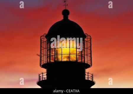 Portugal, Algarve: Romantic sunset at the lighthouse St. Vincent at Cape St. Vincent - Stock Photo