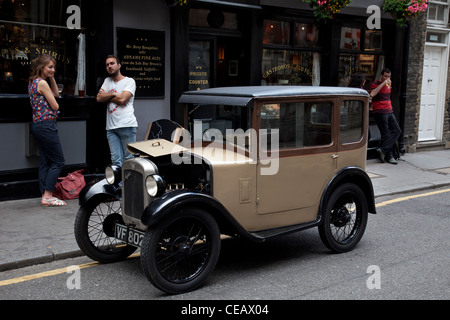 Vintage 1926 Austin Box Saloon car parked outside a pub in London, UK. - Stock Photo