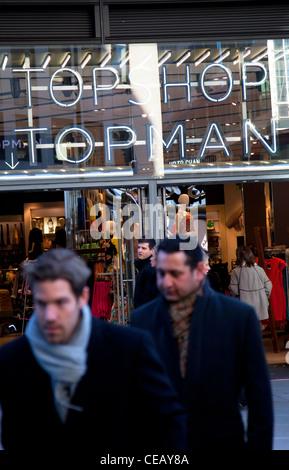Men Walking Past A Topman Topshop Store In London Topshop Is A Very Popular