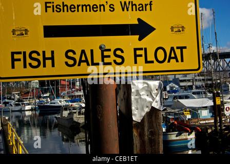 Vancouver False Creek Harbour Authority direction sign to waterfront public fish sales float - Stock Photo