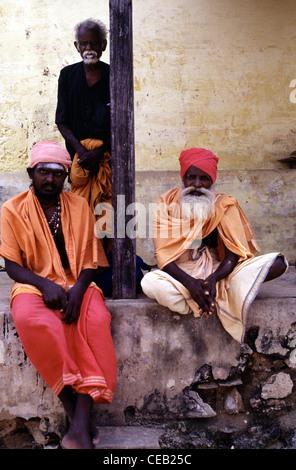 Hindu sadhus wearing traditional garment in the town of  Rameswaram in Tamil Nadu state South India - Stock Photo