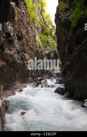 White water near one of the waterfalls in the Partnach Gorge - Partnachklamm - in Garmisch-Partenkirchen in Bavaria, Germany Stock Photo
