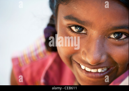 Happy young poor lower caste Indian street girl. Andhra Pradesh, India - Stock Photo
