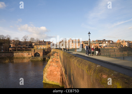 Chester Cheshire View along the red brick Old Dee Bridge over River Dee towards the city walls - Stock Photo