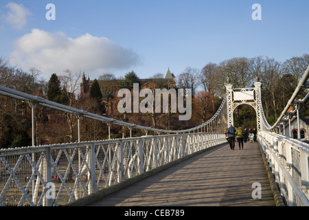 Chester Cheshire View along Queens Park Suspension Bridge over River Dee - Stock Photo
