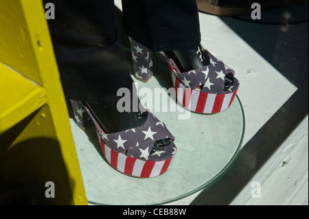 A pair of women's stars and stripes shoes in a shop window. Haight St. San Francisco. USA - Stock Photo