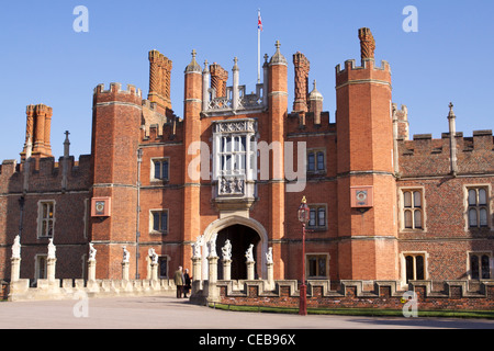 Red brick facade with ornate chimneys of the 'Great Gate House' - the West front of Hampton Court Palace - Stock Photo
