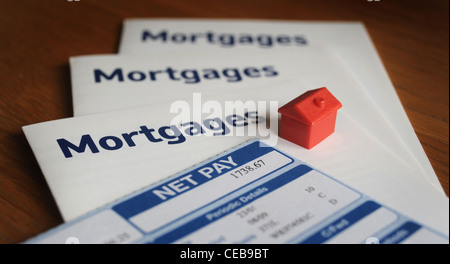 MODEL HOUSE WITH MORTGAGE LEAFLETS AND NET PAYSLIP RE HOME BUYERS BUYING FIRST TIME BUYERS PROPERTY MARKET HOUSING INCOMES UK