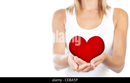 Healthy woman holding heart in hands, female body isolated on white background, conceptual image of health care - Stock Photo