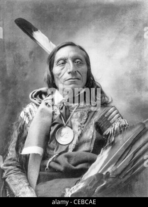Stands and looks back native american cheif circa 1900 stock photo