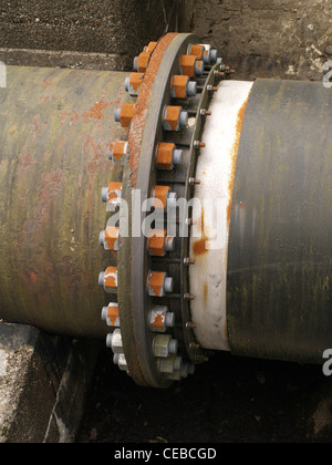 Nuts and bolts holding industrial water pipes together - Stock Photo